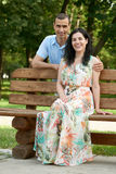 Romantic couple sit on bench in city park, summer season, adult happy people man and woman Stock Images