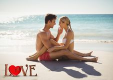 Romantic couple sitting on beach Royalty Free Stock Image
