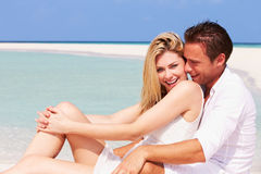 Romantic Couple Sitting On Beautiful Tropical Beach Stock Photos