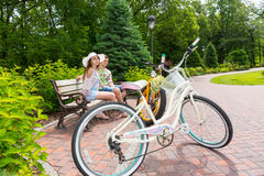 Romantic couple sitting on bench near bikes Royalty Free Stock Images