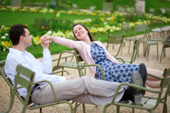 Romantic couple sitting on chairs in Luxembourg garden Royalty Free Stock Photos