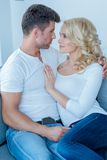 Romantic Couple Sitting on the Couch Royalty Free Stock Photo