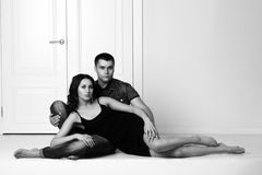 Romantic couple sitting on floor Royalty Free Stock Photos