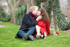 Romantic couple sitting on the grass Royalty Free Stock Photography