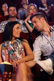 Romantic couple sitting at movie theater Royalty Free Stock Photo
