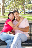 Romantic Couple Sitting On Park Bench Together Stock Photos