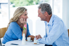 Romantic couple sitting at restaurant Stock Photo