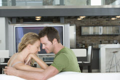 Romantic Couple Sitting On Sofa In Living Room Royalty Free Stock Photos