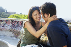 Romantic Couple Sitting On Stone Bench Royalty Free Stock Image