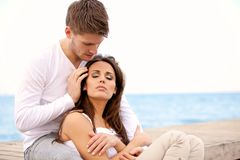 Romantic Couple Sitting Together Stock Photos