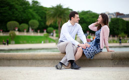 Romantic couple sitting by water Royalty Free Stock Images