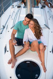 Romantic couple sitting on yacht. Royalty Free Stock Images