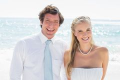 Romantic couple smiling at camera on their wedding day Royalty Free Stock Photography