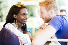 Romantic couple smiling while looking into each others eyes Stock Photography