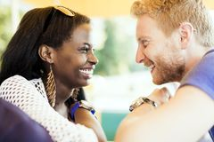 Romantic couple smiling while looking into each others eyes royalty free stock photos