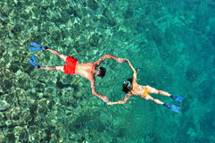 Romantic couple snorkeling. Above view royalty free stock photography