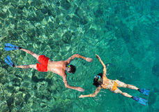 Romantic couple snorkeling stock photos