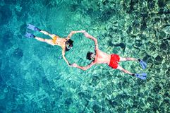 Romantic couple snorkeling in the sea royalty free stock photography