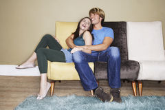 Romantic Couple On Sofa Royalty Free Stock Image