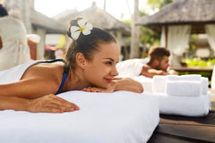 Romantic Couple Spa. People Relaxing, Enjoying Massage Outdoors. Romantic Couple Spa. Closeup Of Beautiful Healthy Happy Smiling Woman, Handsome Man Relaxing At Stock Images