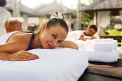 Romantic Couple Spa. People Relaxing, Enjoying Massage Outdoors. Romantic Couple Spa. Closeup Of Beautiful Healthy Happy Smiling Woman, Handsome Man Relaxing At Royalty Free Stock Image