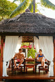 Romantic Couple At Spa Resort Relaxing On Vacation. Relationship Stock Photo
