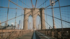 Romantic couple spin and dance at Brooklyn Bridge on a beautiful summer day. Happiness, relationship and love concept 4K stock video footage