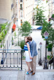 Romantic couple at the stairs on Montmartre in Paris Stock Photography