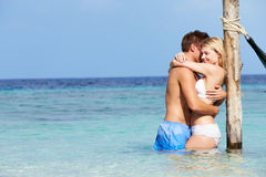 Romantic Couple Standing In Beautiful Tropical Sea Royalty Free Stock Photography