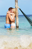 Romantic Couple Standing In Beautiful Tropical Sea Royalty Free Stock Photos