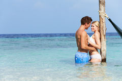 Romantic Couple Standing In Beautiful Tropical Sea. Smiling Stock Photography