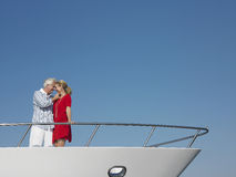 Romantic Couple Standing On Bow Of Yacht Royalty Free Stock Photos