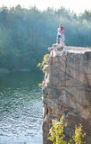 Romantic couple standing on cliff over river Stock Photography