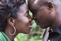 Romantic couple standing face to face and embracing each other Stock Photos