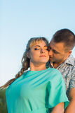 Romantic couple standing and kissing on background summer lake  sunset Stock Photo