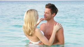 Romantic Couple Standing In Sea stock video