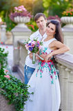 Romantic couple standing in summer park near the rails Royalty Free Stock Photos