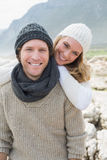 Romantic couple standing together on a rocky landscape Royalty Free Stock Photo