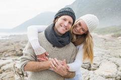 Romantic couple standing together on rocky landscape Stock Images