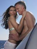 Romantic Couple Standing On Yacht Stock Image