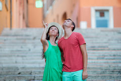 Romantic couple on Steps in Rome enjoy italian holidays. Happy lovers walking on the travel landmark tourist attraction. Happy tourist couple, men and women stock photo