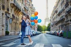 Romantic couple near the Eiffel tower in Paris stock images