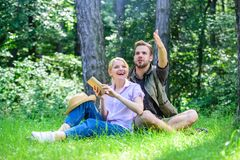 Romantic couple students enjoy leisure looking upwards observing nature background. Couple in love spend leisure in park. Or forest. Romantic date at green stock photos