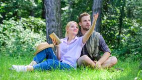 Romantic couple students enjoy leisure looking upwards observing nature background. Romantic date at green meadow. Couple in love spend leisure in park or royalty free stock photos