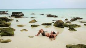 Romantic couple sunbathing inside fantastic crystal water stock video