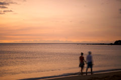 Romantic couple in Sunset. Romantic couple walking on beach in hawaii during sunset, with motion blur Stock Photo
