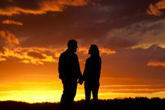 Romantic couple at sunset. Stock Photography
