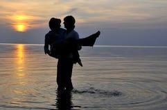 Romantic couple at sunset stock image