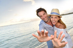 Romantic couple at sunset on the beach isolated Stock Images