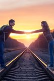 Romantic couple at sunset on railroad Stock Images